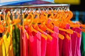 Colors of rainbow. Variety of casual shirts on hangers  — Stock Photo