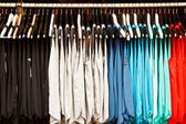 Colors of rainbow. Variety of casual shirts on hangers  — Foto Stock
