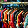 Colors of rainbow. Variety of casual shirts on hangers — Stock Photo #41983915