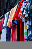 Colors of rainbow. Variety of casual shirts on hangers  — ストック写真