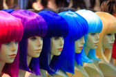 Mannequin with colorful wig and facial accessories  — Stockfoto