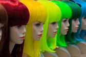Mannequin with colorful wig and facial accessories  — Stock Photo