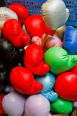 Boxing gloves in the basket of store — Stock Photo