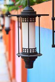 Close up of a street lamp with colorful background — Stock Photo