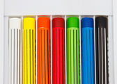 Crayons lined up in rainbow isolated on white background — ストック写真