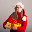 Young beautiful woman with a holiday gift — Stock Photo #37456223