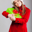 Stock Photo: Young beautiful woman with a holiday gift
