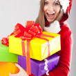 Young beautiful woman with a holiday gift — Stock Photo #37458603