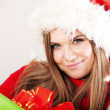 Young beautiful woman with a holiday gift — Stock Photo #37458755