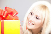 Young beautiful woman with a holiday gift — Stock Photo
