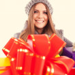 Young beautiful woman with a holiday gift — Stock Photo #37461575