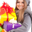 Young beautiful woman with a holiday gift — Stock Photo #37461687
