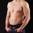 Young man showing his muscles — Stock Photo