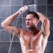 Man taking shower — Stock Photo