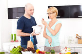 Couple in the kitchen cooking — Foto Stock