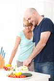 Couple in the kitchen cooking — Stock Photo