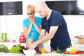 Couple in the kitchen cooking — Photo