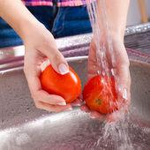 Washing fresh vegetables — Stock Photo