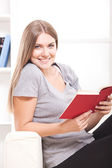 Happy woman at home sitting using laptop — Foto Stock