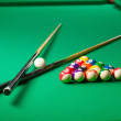 Billiards. Top view of billiard balls and cues on green table — Stock Photo #35165727