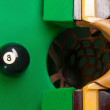 Pool ball. Top view of black billiard ball on green table — Stock Photo #35166013