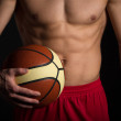 Basketball Player. Shirtless Male Basketball Player Holding ball — Stock Photo #35166059