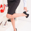 Young woman wearing shoes — Stock Photo