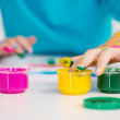 Adorable girl finger painting. — Stock Photo
