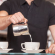 Stock Photo: BaristPouring Froth Art