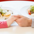 Hands. Man and woman at the restaurant - holding hands together — Stock Photo