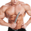 Bodybuilder with knife. Muscular man holding knife isolated on white — Stock Photo