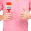 Painter with paintbrush. Man holding paintbrush and giving thumbs up — Stock Photo