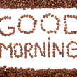Arranged Coffe Beans. Coffee beans arranged in phrase GOOD MORNING in frame — Stock Photo