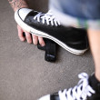 Drop it. Man put his foot on gangster gun — Stock Photo