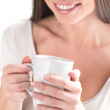 Good morning. Close-up of an attractive woman holding coffee cup — Stock Photo