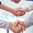 Handshaking partners. Photo of tree pairs of partners arms hands — Stock Photo