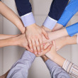 Hands in. Closeup of pile of hands of a business team showing unity — Stock Photo
