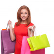 Woman in red dress holding shopping bags  — Stock Photo