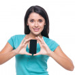Cheerful young woman showing mobile phone  — Stock Photo