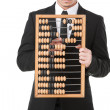 Businessman holds abacus — Stock Photo