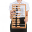 Businesswoman holds abacus — Stockfoto