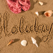 Holiday written in sand — Stock fotografie