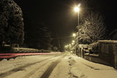 Red row on a snowy weather evening — Stok fotoğraf