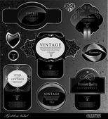 Black gold labels — Stock Vector