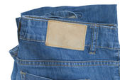 Several tools on a denim workers pocket — Stock Photo