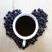 Cup of fresh coffee on table, view from above — Foto de Stock