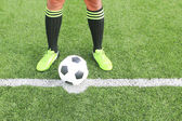 Soccer ball with foot of player kicking it — Stock Photo