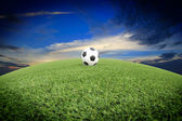 View of green striped football field with soccer ball — Stock Photo