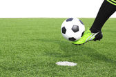 Kicking a soccer ball on field — Stock Photo