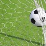 Soccer ball in goal — Stock Photo